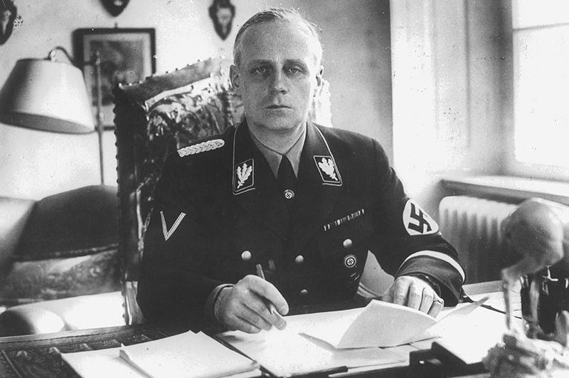 Nazi Reich Foreign Minister Joachim von Ribbentrop in uniform at his desk.